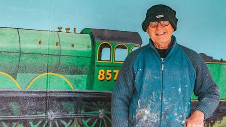 Colin Seal and his completed train mural in Sheringham. Pictures: Gareth Gabriel