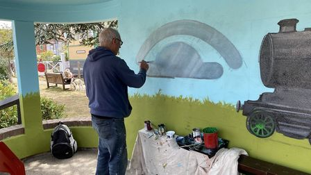 Colin Seal working on his new train mural in Sheringham. Pictures: Colin Seal