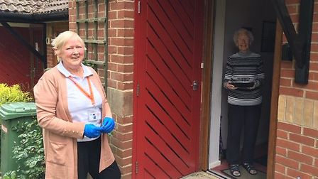 Margaret Mildwater, 90, with Liz Ward, left, from Aylsham Care Trust. Picture: ACT