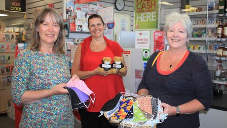 West Runton Village Store and Post Office owner Andrea Loakes (back) with customers Emma Askew (left