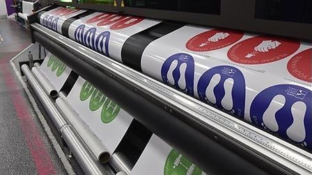 Stickers being printed at Structure-flex in Cromer to help people social distance ahead of the reope