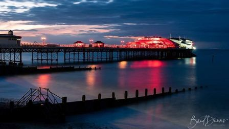 Cromer Pier's Pavilion Theatre lit up a Light It In Red campaign to draw attention to the plight of