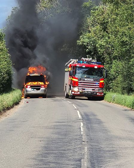 A car caught fire at Egmere, on the main road between Fakenham and Wells. Picture: Brian Duff