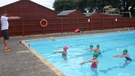 Sam Watts, lead coach, teaches swimmers stroke technique. Picture: Supplied by North Norfolk Vikings