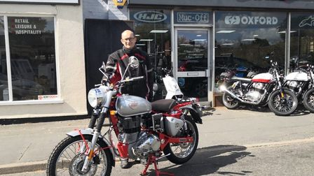 Worstead Baptist Church minister Rev Patrick Coghlan on his beloved Royal Enfield motorcycle.Photo: