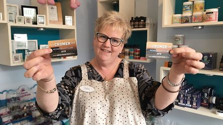Jule Cole, from Benedict's Cove, pictured in 2018, displaying Enjoy Cromer More membership cards. Pi