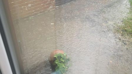 Angeline Connolly from Sherringham returned home from walking her dog to find her front garden flood