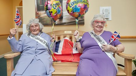 Centenarians Pattie Knopp, left, and Marion Bubs Wilkinson celebrate the 20th birthday of Lloyd Cour