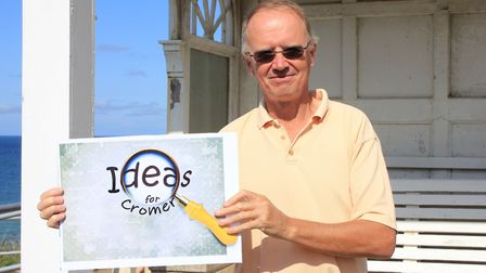 Cromer Artspace trustee Barry Meadows with a siign advertising the new public art project.Photo: KAR