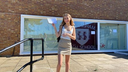 Samantha Graves, 16, SHeringham High School GCSE student, with his results. Picture: Ella Wilkinson