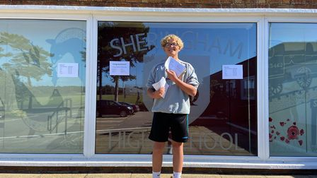 Jesse Howell, 16, SHeringham High School GCSE student, with his results. Picture: Ella Wilkinson