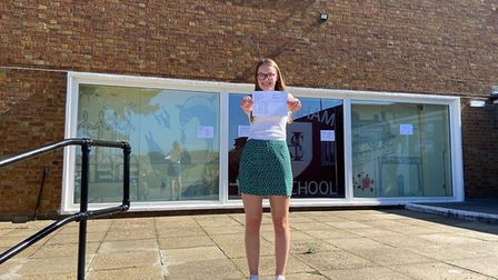Daisy Hedges, 16, Sheringham High School GCSE student, with her results. Picture: Ella Wilkinson
