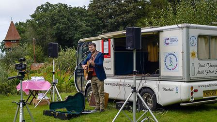 Sheringham musician Paul Thompson at the launch of his book about driving an electric milk float aro
