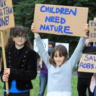 Youngsters protesting about National Trust cuts outside Sheringham Park.Photo: KAREN BETHELL
