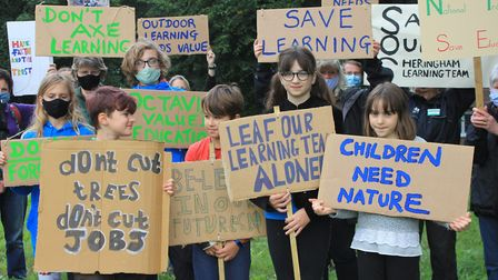 National Trust volunteers and youngsters protesting about the axing of Sheringham Park's learning an