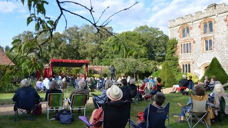 The audience relaxes to classic music in Mannington Hall's walled garden at the Sheringham Little Th