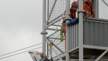 Firefighters practice on a drill tower. Photo: Denise Bradley.