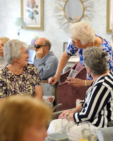 Dame Mary Peters speaking with residents at the opening of the Louis Arthur Court retirement living