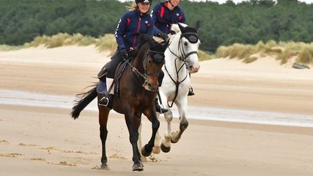 Georgie and Edward ride into Holkham beach . Picture: The Veale Family