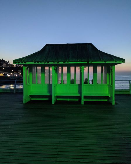 Cromer Pier is being lit up green in the evenings to mark Recycling Week. Picture: Supplied by North