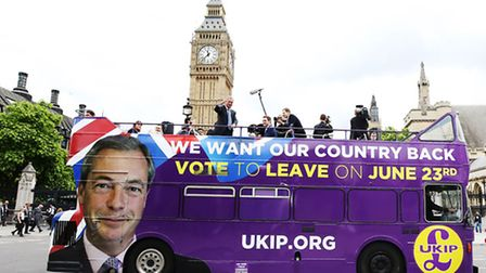 Ukip leader Nigel Farage passes the Houses of Parliament in London, on the Brexit Bus