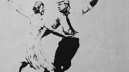 A piece of street art by artist Bambi depicting Prime Minister Theresa May and US President Donald T