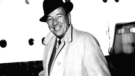 Actor and Playwright Noel Coward on arrival at Southampton from New York, aboard the liner Queen Mar