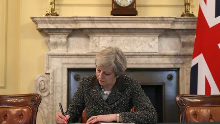 Theresa May signs the letter notifying the EU that Article 50 has been triggered