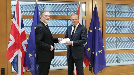 Sir Tim Barrow hand delivers the Brexit letter to EU Council President Donald Tusk, in Brussels. Alexander Britton/PA Wire