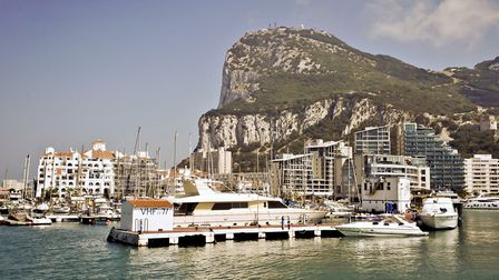 A general view of buildings and the marina in front of the Rock of Gibraltar.