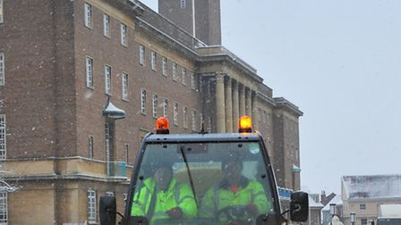 Norwich wakes up to more snow and as some people made their way to work workers clear the footpaths
