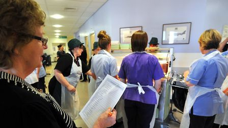 Eirlys McLean, trustee for Age UK Norfolk, monitoring lunch being served in one of the wards at the