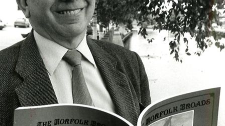 Basil Gowen with his Norfolk post card book