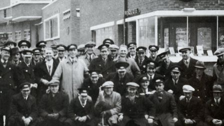 A postcard featuring Norwich bus drivers in the 1930s
