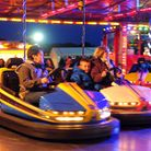 Families enjoy on of Norfolk's travelling funfairs at Barnham Cross Common in Thetford