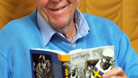 Roy Blower with a book about his hero, speedway legend Ove Fundin. Photo: Bill Smith