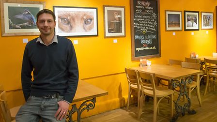 Jonathan Lewis exhibiting his wildlife photographs at Expresso cafe in Norwich