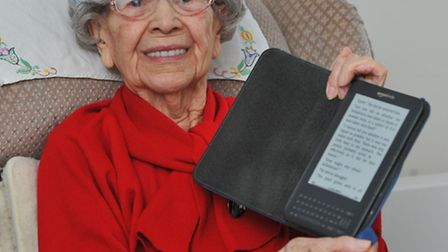 Doris Davison reading her Kindle and getting ready for her 100th birthday party at the Great Hospita