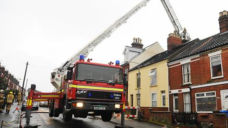 The aftermath of the fire at two terraced houses in Knowsley Road. Fire fighters damp down hot spots