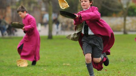 Norwich Cathedral Pancake Races in the Close, Norwich. Photo: Steve Adams