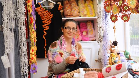 Designer Rodica Watkins, with her knitted and crochet designs at her shop Corider Knit. Rodica is ta
