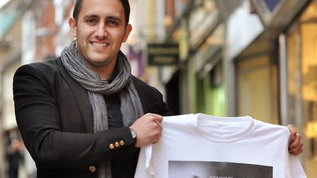 Graphic designer Steven Stokes with the Norwich fashion week T shirt. Photo: Bill Smith