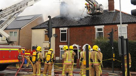 Flashback to March 24. Firefighters tackle the fire in the roof of four houses in Magpie Road. Pictu