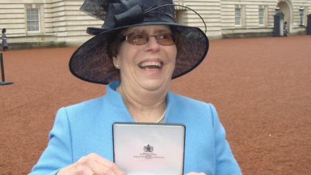 Margaret Wynn with her MBE at the Palace- Picture supplied by St. Cuthberts Day Care Centre