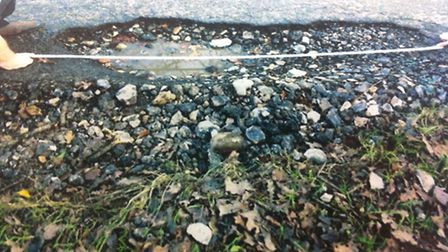 The pot-hole in Fakenham Road that caused £300 damage to Charlotte Westall's car.Submitted picture