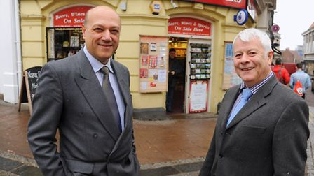 Geoff Curran, right, retiring after 34 years from the Cigs and Papers newsagents, Exchange Street, w