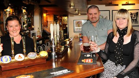 Pub of the Week, the Black Swan at Horsham St Faith. Managers Richard and Sophie Pride, with Emma Wr