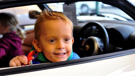 Charlie Ryan evidently enjoying his VIP tour of Long Stratton motors and their glamorous cars. Phot