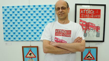 Artist Rory Bowskill with some of his work on show at The Wall exhibition in the Forum.PHOTO BY SIMO