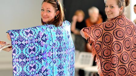 Students practising modelling their shawls at the Norwich University of the Arts. Photo: Bill Smith